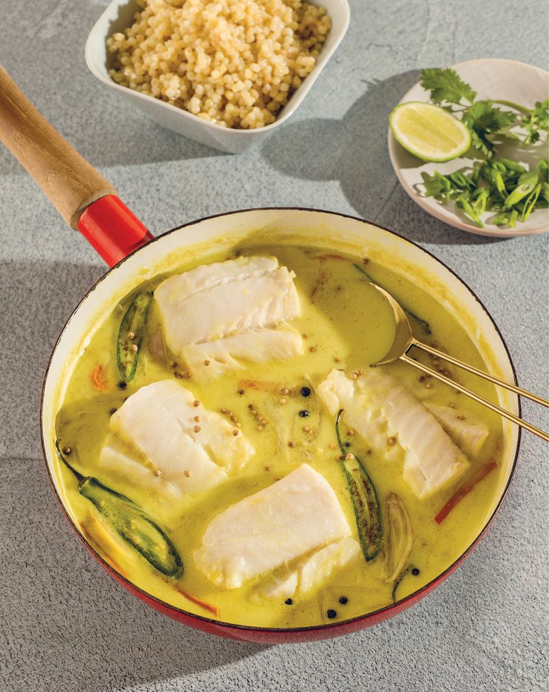 """Eating hot foods to cool off comes into play with Coconut Milk, Turmeric, Ginger and Black Pepper-Poached Cod With Israeli Couscous from Vanessa Seder's """"Eat Cool: Good Food for Hot Days"""" cookbook. (Courtesy of Rizzoli USA)"""