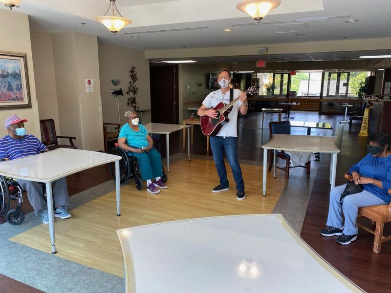 Music Therapist, John Abel, leading a music therapy session at A.G. Rhodes nursing home in Atlanta during the coronavirus pandemic.