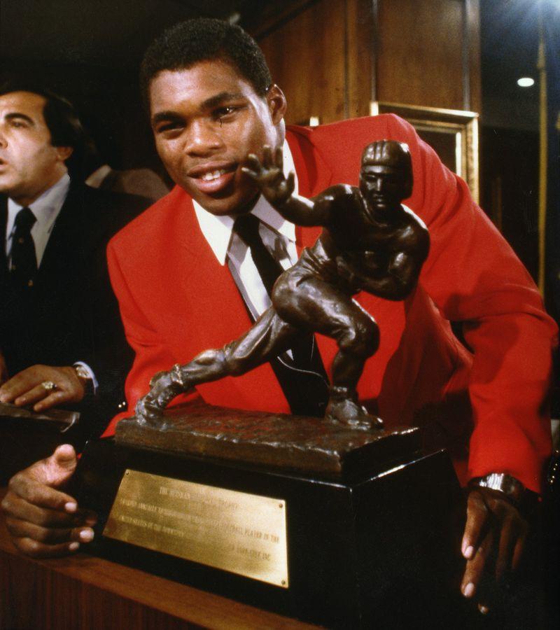 Herschel Walker accepting the Heisman Trophy, 1982. Calvin Cruce / AJC file photo