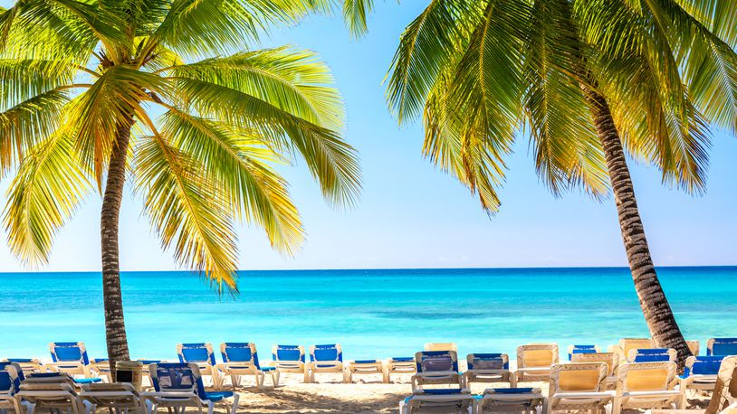 A beach with sun loungers and palms on Saona Island in the Dominican Republic. (Nikolay Antonov/Dreamstime/TNS)