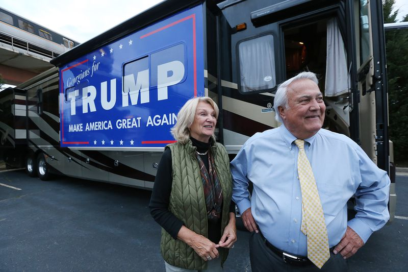 """Georgia Public Service Commissioner Lauren """"Bubba"""" McDonald, Jr., a Donald Trump supporter, and his wife Shelley speak to a reporter after arriving in their recreational vehicle at the Corey Center for a watch party on Monday, March 1, 2016, Atlanta. Curtis Compton / ccompton@ajc.com"""