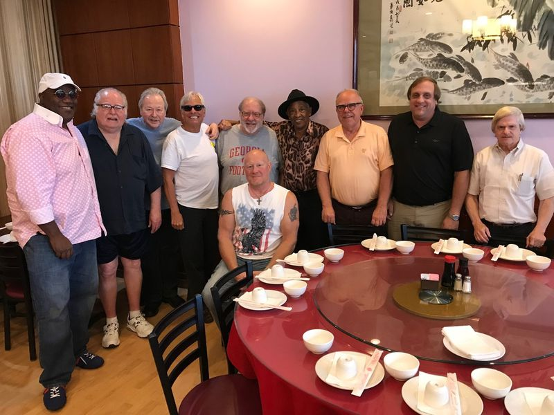 The May 2019 meeting of the ATL Music Lunch Club included old-school Georgia soul music artist Hermon Hitson (center). Posing for the traditional post-lunch shot were (back, from left): Joey Sommerville, Dick Wooley, Mark Pucci, Forrest Haller, Bill King, Hitson, Randy Roman, Glenn Halverson and Vince Canipelli. In front is John McKnight. (Courtesy of Mark Pucci)