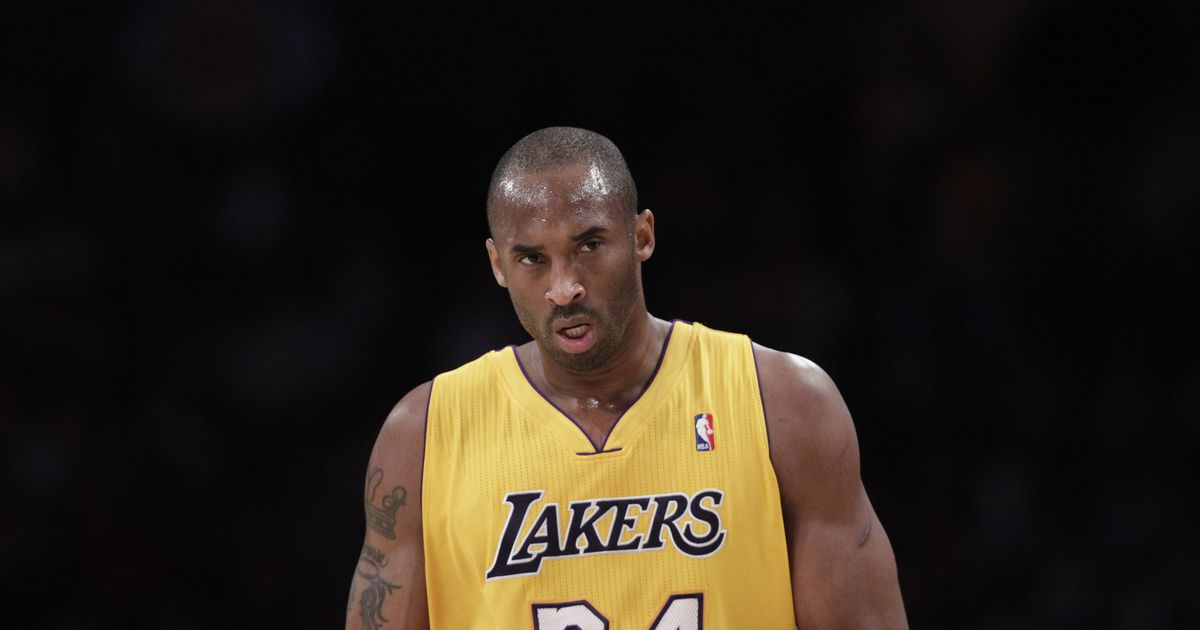 Why did Kobe Bryant wear two jersey numbers?