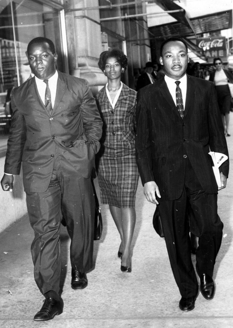 Oct. 18,1960 - ATLANTA, GA - Demonstrators (l-r) Lonnie King, MARILYN PRYCE (according to a source) and Martin Luther King Jr. are taken to a police car after being arrested for a sit-in protest at Rich's. (Charles Jackson/AJC staff) 1960