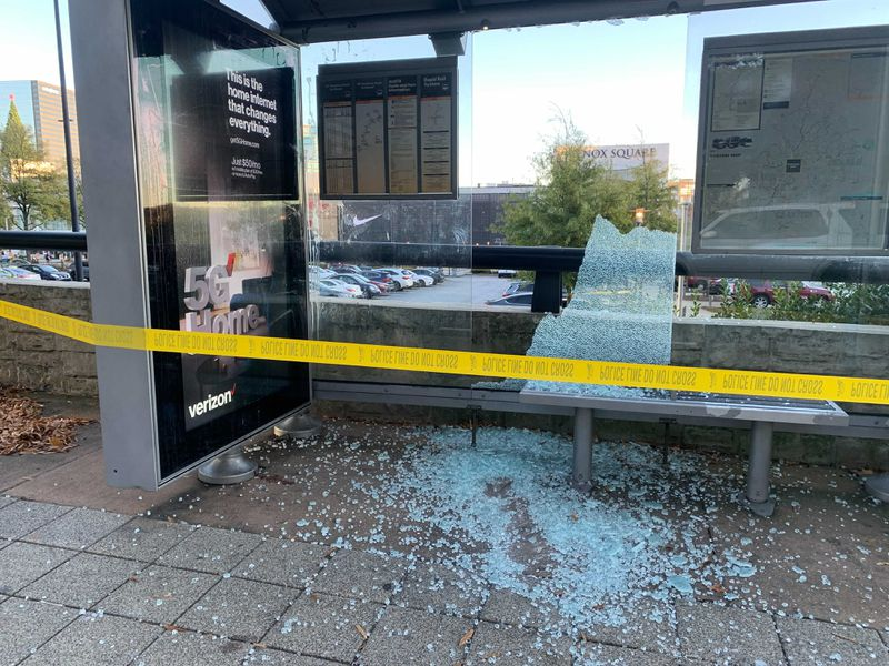 Bullets from a shooting that erupted inside the new Apple store in Lenox Mall shattered the windows of a MARTA bus stop across the street Friday afternoon. Credit: ADA WOOD / ADA.WOOD@AJC.COM