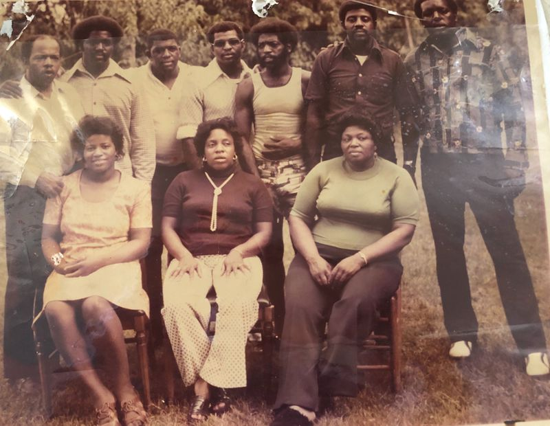 """John Lewis, upper left and his nine brothers and sisters circa 1969.  Front row L-R Rosa, Ethel, Ora Back row L-R, John, Henry, William, Samuel, Freddie, Edward and Adolph Lewis is the most famous one, but Rosa Tyner, the youngest, said all of her older brothers and sisters were exceptional. Ora worked in nursing. Edward, the oldest boy, was deaf, but refused to get on disability and he took care of Willie Mae after Eddie died in 1977. """"My mother, we called her Mul, was very humble. She didn't say much and I never really heard her cuss. Dad was a humble, good person,"""" Tyner said. """"All of the children were raised right. I'm not saying that we were saints. But if we did something wrong, we got it straight."""""""