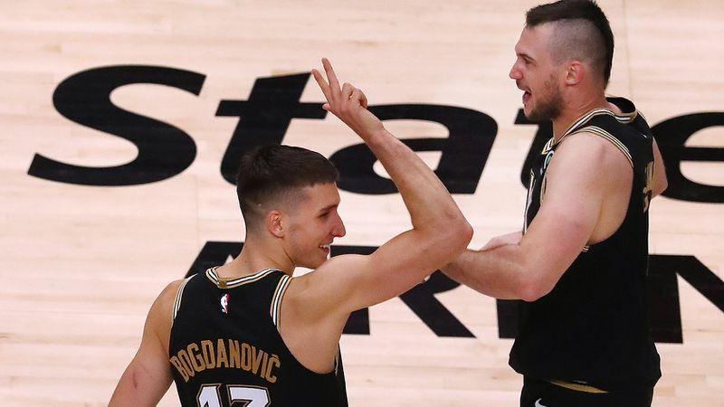 Hawks guard Bogan Bogdanovic (left) celebrates with forward Danilo Gallinari (right) after Gallinari slammed in a dunk for two points of 113-96 victory in Game 4 of first-round NBA playoff matchup against the New York Knicks Sunday, May 30, 2021, at State Farm Arena in Atlanta. (Curtis Compton / Curtis.Compton@ajc.com)