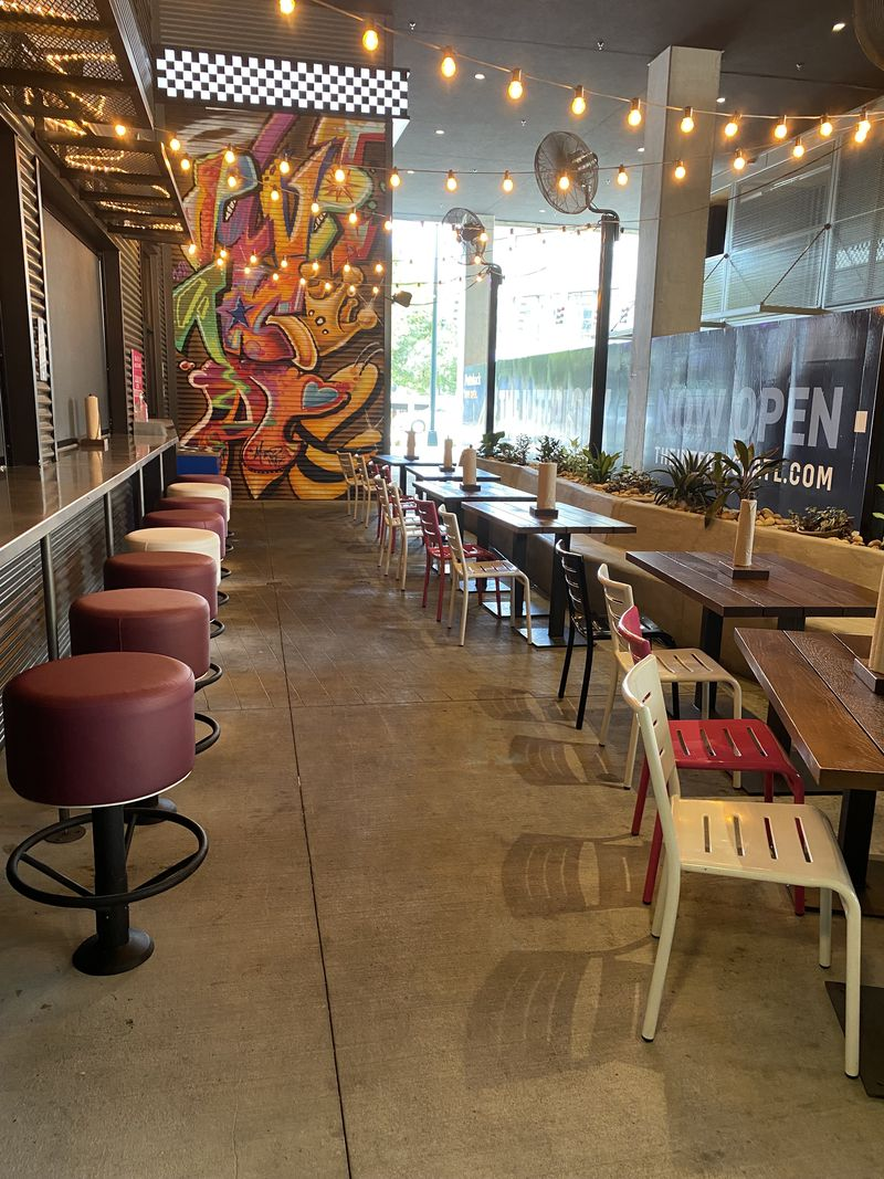Velvet Taco offers indoor dining as well as outdoor seating on a covered patio breezeway that connects shops at the Interlock. (Ligaya Figueras / ligaya.figueras@ajc.com)
