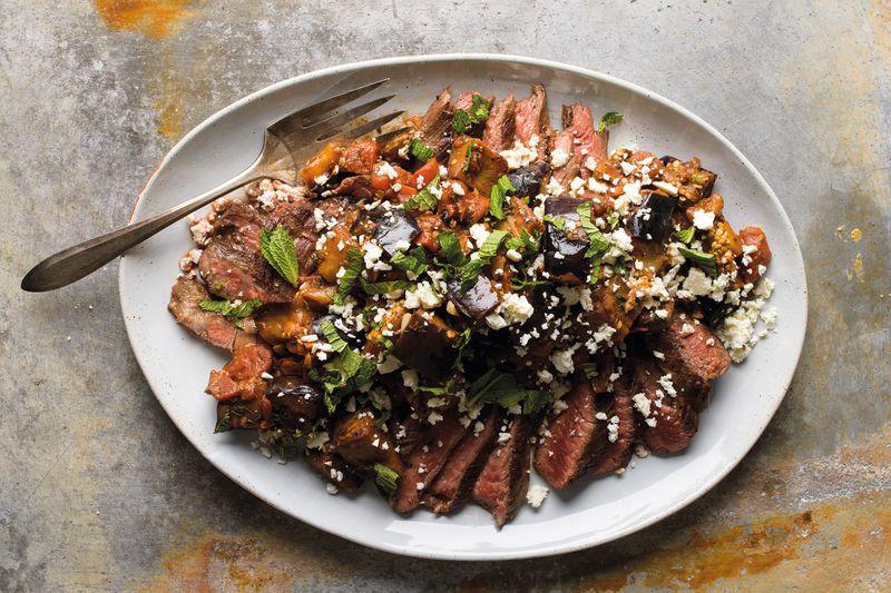 "Flank Steak with Tomato-Eggplant Ragu, from ""Milk Street: Tuesday Nights Mediterranean"" (Voracious; 2021; $35). Courtesy of Connie Miller, CB Creatives Inc."