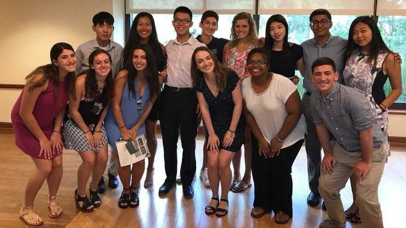 Joey Ye (in the white shirt and black pants) takes a group picture during the first-year student orientation at Emory University in 2017. Ye has been taking courses remotely from China, where he was born and raised, since the coronavirus pandemic took hold in Georgia in March 2020. He became friends with Zariah Jenkins, standing in the front row, second from the right. (Courtesy of Zariah Jenkins)