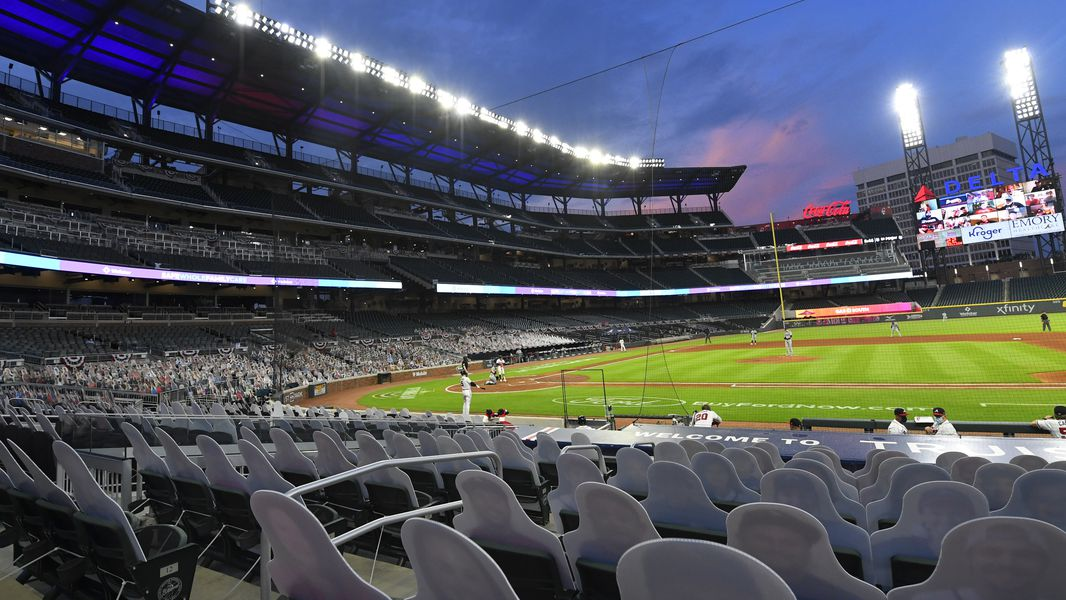 Cardboard cutouts of fans in the otherwise empty seats face the field at the Braves' Truist Park for a game against the Tampa Bay Rays, Thursday, July 30, 2020 in Atlanta.