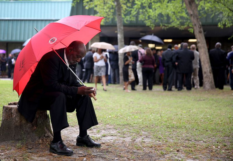 Eddie Bryan waits to enter the W.O.R.D. Ministries Christian Center for the funeral of Walter Scott, after he was fatally shot by a North Charleston police officer after fleeing a traffic stop in North Charleston. (File photo by Joe Raedle)