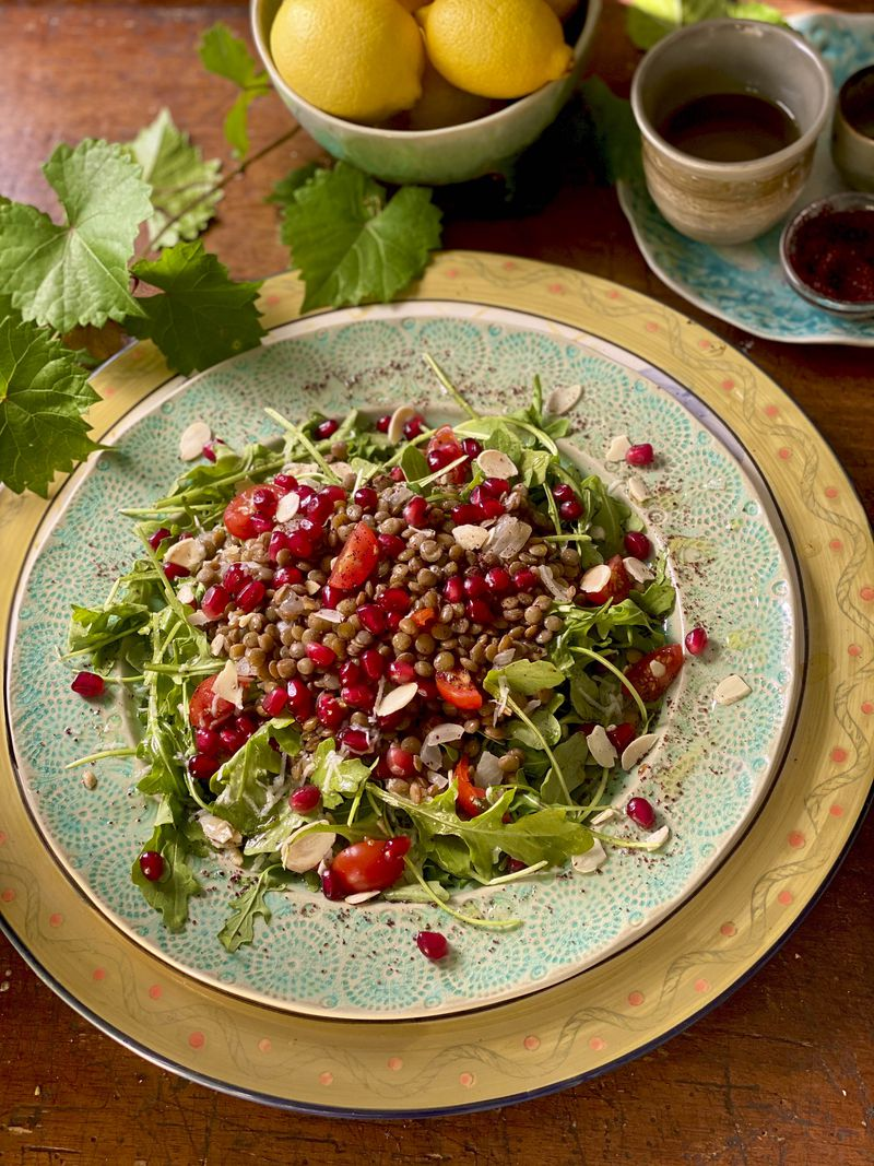 Paulina Brand's Arugula with Warm Lentils and Pomegranate is the perfect healthy meal for winter. Courtesy of Paulina Brand