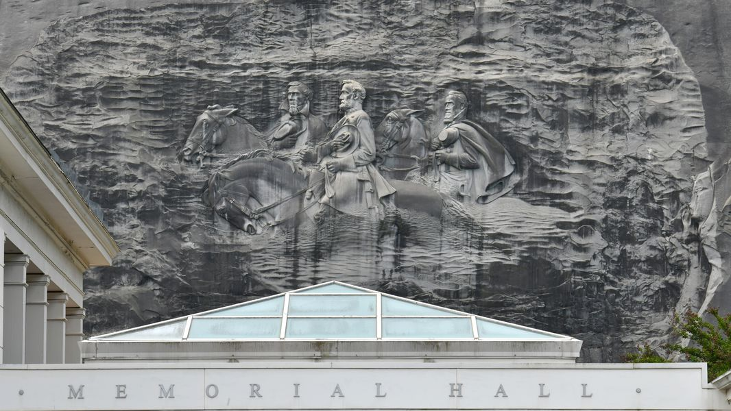 April 20, 2021 Stone Mountain - Memorial Hall (foreground) and Confederate Memorial Carving (background) at Stone Mountain Park on Tuesday, April 20, 2021. (Hyosub Shin / Hyosub.Shin@ajc.com)
