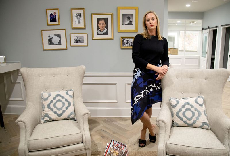 Eleanor's Place founder Jennifer Morgan stands in front of a collection of photographs of Ruth Bader Ginsburg at her private, women-only co-working space in Atlanta Saturday, September 19, 2020.  STEVE SCHAEFER / SPECIAL TO THE AJC