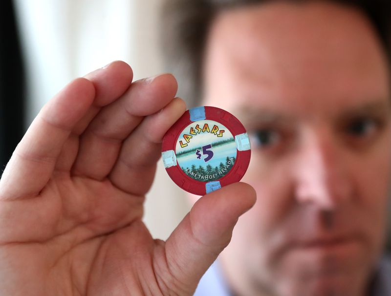 "Matt Paxton, a former expert on ""Hoarders"" shows off a Caesar's chip, one of his personal legacy items. Curtis Compton / Curtis.Compton@ajc.com"