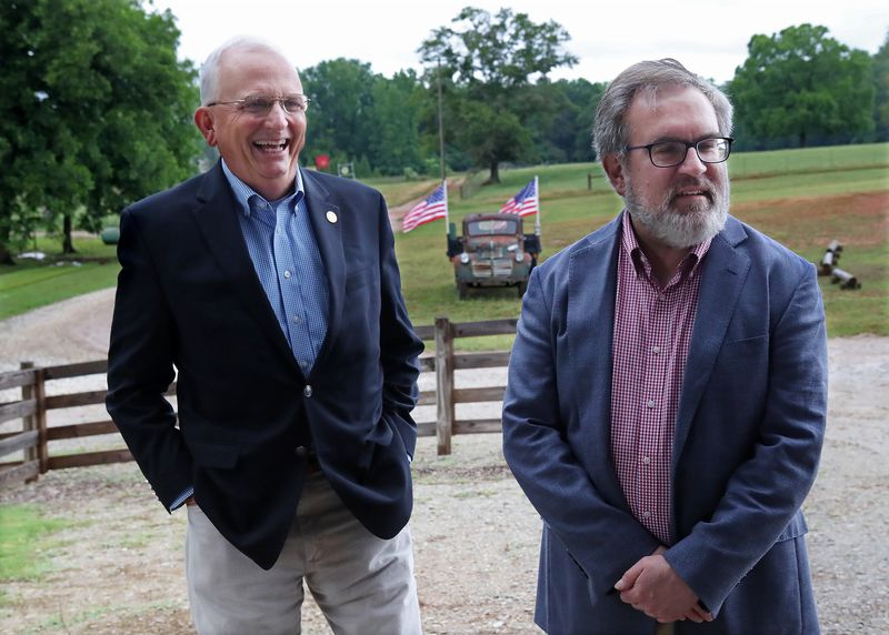 U.S. Environmental Protection Agency (EPA) Administrator Andrew Wheeler (right) shares a laugh with Georgia Agriculture Commissioner Gary Black (left) while kicking off his Georgia swing at Southern Belle Farm on Wednesday, May 27, 2020, in McDonough.  Curtis Compton ccompton@ajc.com