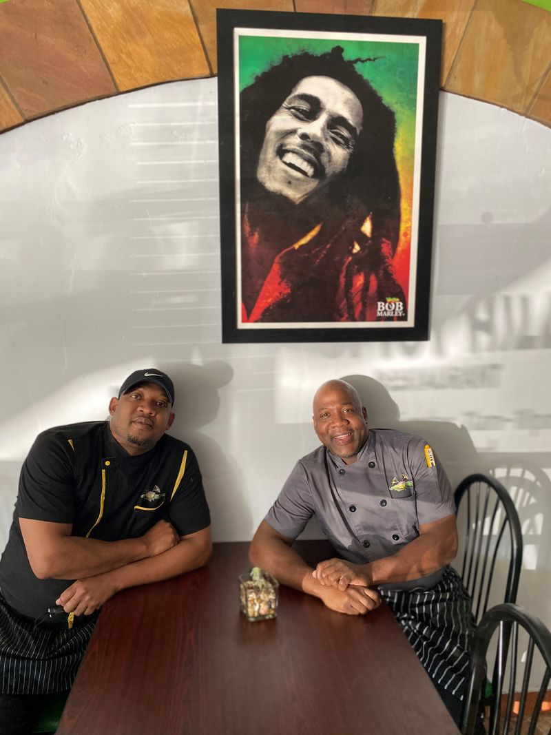 Alrick and Desrick Smith, brothers who grew up together in Jamaica and went their separate ways, have reunited to open Spicy Hill restaurant in Jonesboro. Wendell Brock for The Atlanta Journal-Constitution