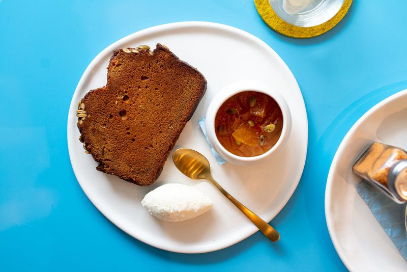 Warm Pumpkin Bread with whipped Decimal Place feta, and pumpkin seed agrodolce. Mia Yakel for The Atlanta Journal-Constitution