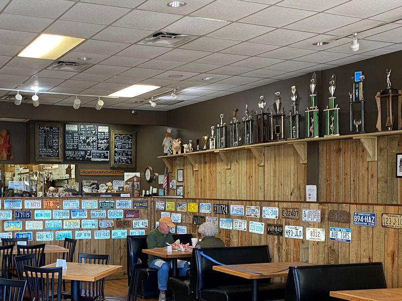 A shelf full of barbecue competition trophies greets visitors to Dave Poe's BBQ in Marietta. Bob Townsend for The Atlanta Journal-Constitution