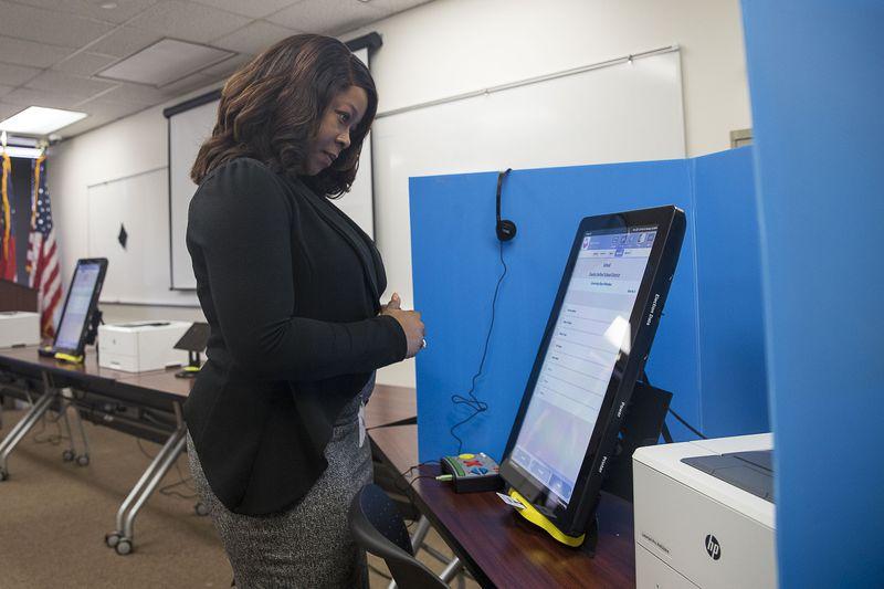 """09/16/2019 -- Atlanta, Georgia -- Breanna Thomas, Election liaison for the Georgia Secretary of State, uses the new Georgia voting machines at the James H. """"Sloppy"""" Floyd building in Atlanta, Monday, September 16, 2019. (Alyssa Pointer/alyssa.pointer@ajc.com)"""