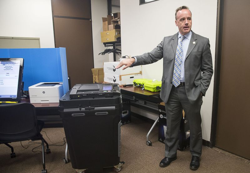 """09/16/2019 -- Atlanta, Georgia -- Chris Harvey, director of elections division for the Georgia Secretary of State, shows off the new Georgia voting machines during a demonstration at the James H. """"Sloppy"""" Floyd building in Atlanta, Monday, September 16, 2019. (Alyssa Pointer/alyssa.pointer@ajc.com)"""