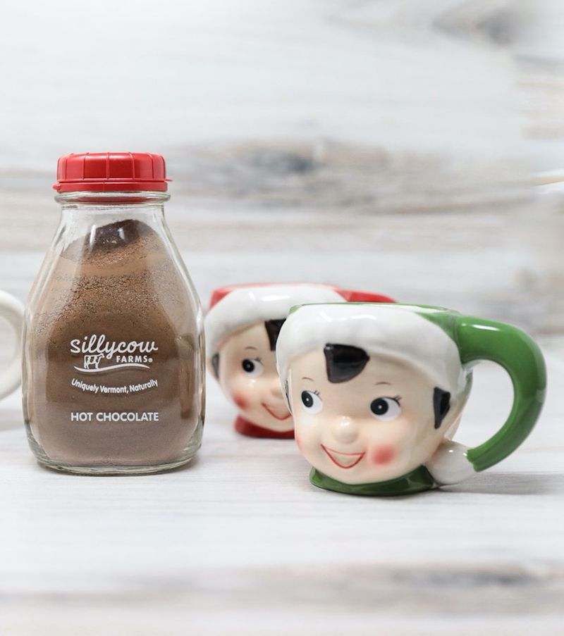 Festive ceramic elf mugs commemorate Christmas in red or green and a bottle of hot chocolate mix makes the season even sweeter.  Courtesy of Lucy's Market