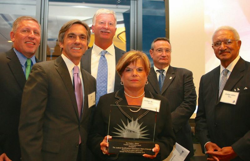 Jeff Davis (second from left) is the former executive director of the State Bar of Georgia and former director of the state Judicial Qualifications Commission. In this photo, he and members of the judicial watchdog agency accept the Georgia First Amendment Foundation's 2014 Freedom of Information Award. Also in the photo, from left, are Lester Tate, Robert Ingram, Judge Brenda Weaver, Richard Hyde and Judge John Allen. (AJC file)