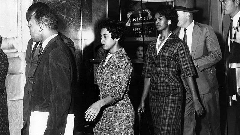 Martin Luther King (left front) and Lonnie King are arrested at Rich's in Atlanta, Ga. on Oct. 19, 1960.