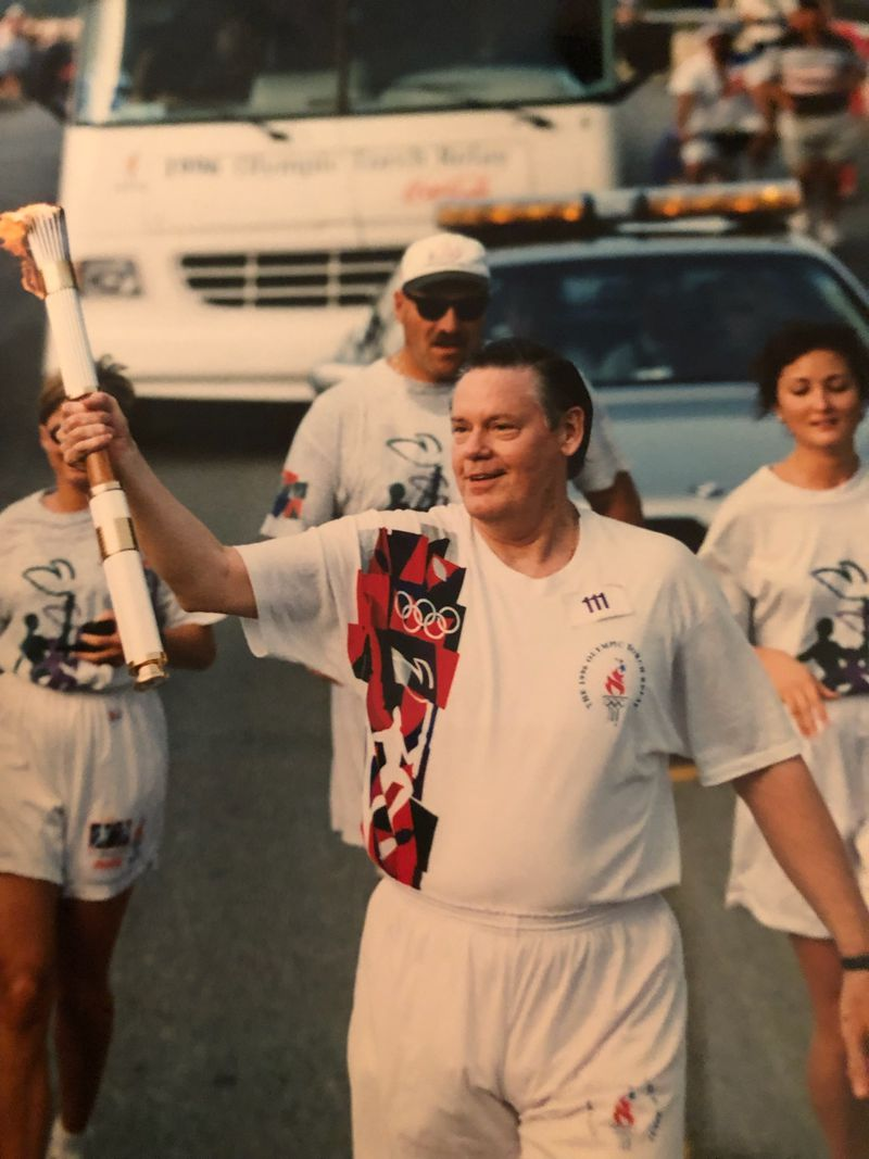 In the run-up to the 1996 Olympics, Dick Yarbrough, an Atlanta Olympic official, was allowed to carry the torch near Atlanta.  (Courtesy Dick Yarbrough)