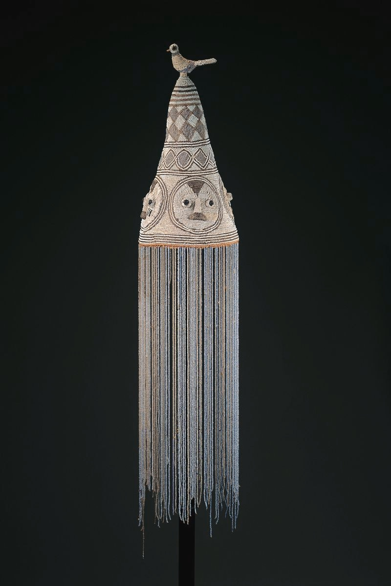 """A Yoruba crown of Obatala or """"king"""" made in the late 19th or early 20th-century, in Nigeria. The unknown artists were likely women who crafted the crown of glass beads, cloth, fiber and leather. Courtesy of the High Museum of Art"""