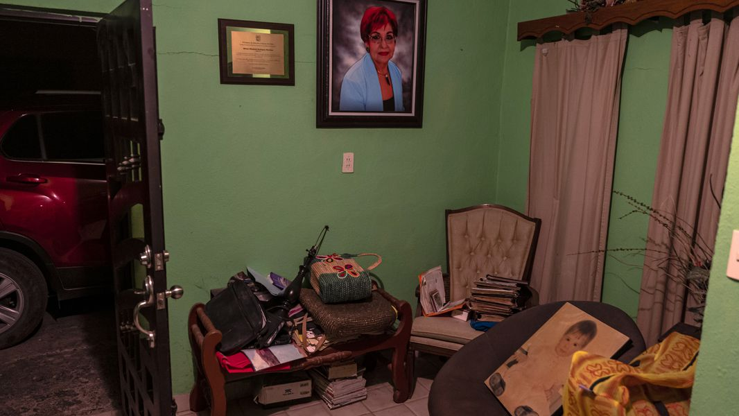 A portrait of Miriam Rodríguez hangs on the wall of her home in San Fernando, Mexico, where her husband was watching television when she was gunned down outside in 2017.