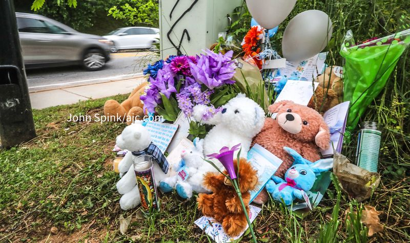 Friends and neighbors left flowers and plush toys at a memorial for 15-year-old Diamond Johnson, who was fatally shot near an Atlanta shopping plaza.
