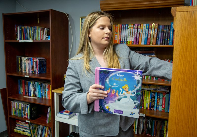 Josie Dunlap checks the supply of books in the resource room at Eastside Mosaic Church in Marietta. PHIL SKINNER FOR THE ATLANTA JOURNAL-CONSTITUTION.