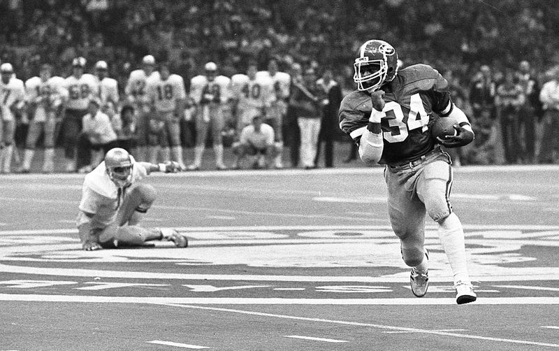 Georgia's Herschel Walker has a full head of steam going against Notre Dame in the 1981 Sugar Bowl. AJC file photo