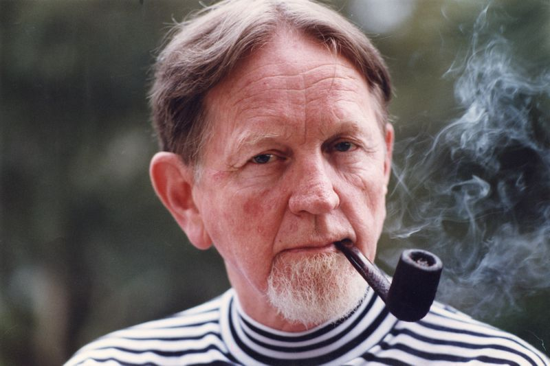 Bobby Lee Cook, in 1991 photo, with his trademark pipe, which he had to retire years later for health reasons. (DIANE LAAKSO / THE ATLANTA JOURNAL-CONSTITUTION)
