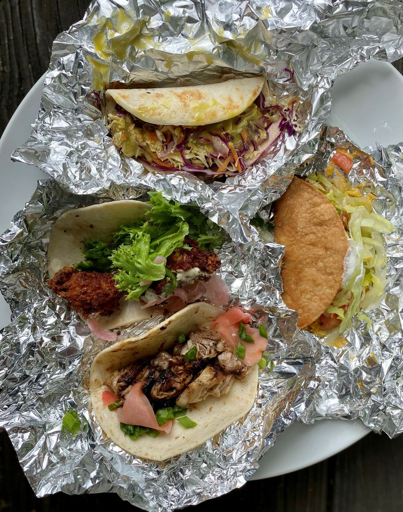 JenChan's, a delivery supper club and restaurant in Cabbagetown, has started a taco pop-up called Justacos. Shown here are tacos (clockwise from the top) made with hoisin Boston butt, Taco Bell-style fillings, short rib and fried oysters. (Wendell Brock for The Atlanta Journal-Constitution)