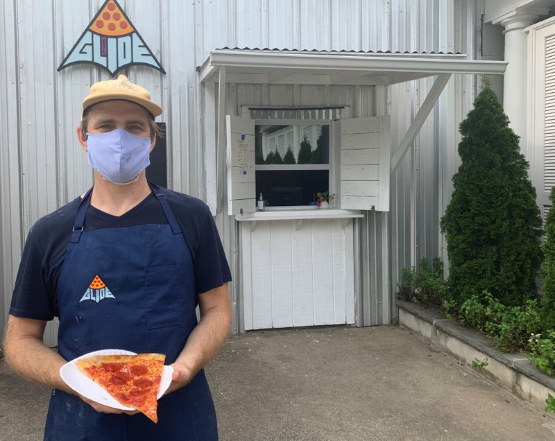 Rob Birdsong in front of his Glide Pizza window on the Eastside Beltline