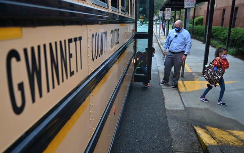 Students wearing masks arrive to Jackson Elementary School in Gwinnett County in this August 26, 2020 file photo. Vaccinating teachers in Gwinnett County, Georgia's largest school district, will not be a quick process, school officials said. (Hyosub Shin / Hyosub.Shin@ajc.com)