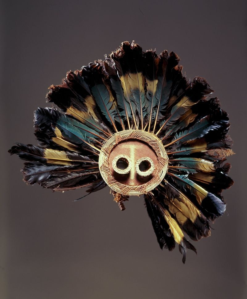 This is a Pende mask from the Democratic Republic of the Congo. The piece was made in the late-19th or early-20th century, of great blue turaco feathers, fiber, and wood. It's part of the High Museum of Art's African Art collection.