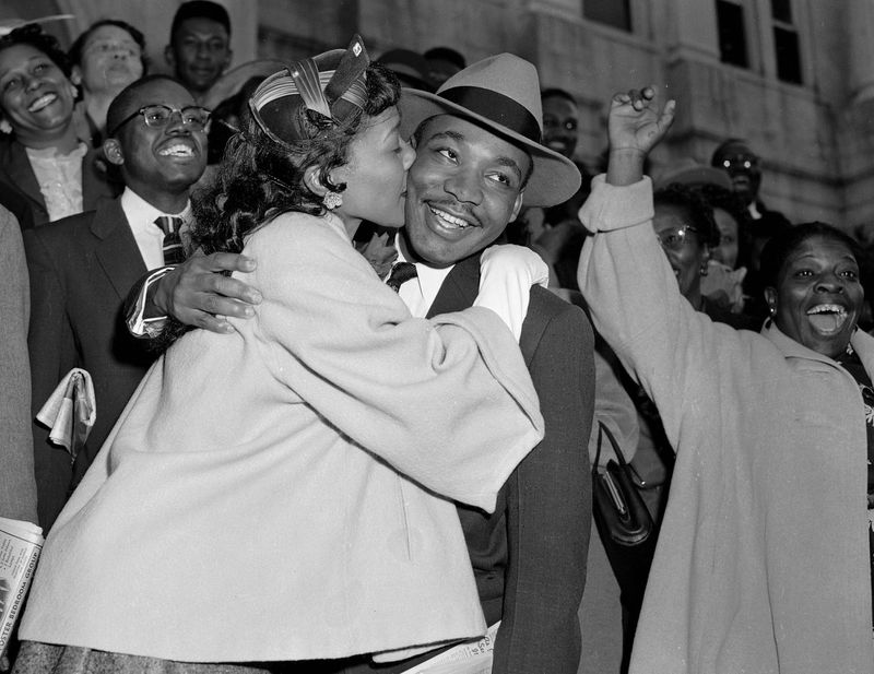 FILE - In this March 22, 1956, file photo, the Rev. Martin Luther King Jr. is welcomed with a kiss by his wife, Coretta, after leaving court in Montgomery, Ala. (AP Photo/Gene Herrick, File)